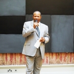 LLEWELLYN XAVIER ADDRESSING GUESTS AT THE ROYAL ACADEMY